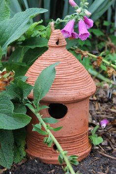 Clay bird house resting in my garden