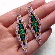 Alta Slender Diamond Shaped Beaded Dangle Earrings in Green, Dusty Pink, Black and Gold Intricate, dainty and tres chic, these diamond earrings will be your new best friends...or at least your best accessory. Measuring approx. 50mm from tip to top, they are made using high-quality, gold-filled earring hooks and tiny Japanese glass seed beads, which I have woven together one at a time. These are made to order. Custom colour requests are welcome!  Please contact me for current turn around time…