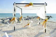 Sunflowers can add a little fall inspiration to your beach wedding.  Our dark bamboo canopy is the perfect complement for your autumn wedding #simpleweddings #beachweddings