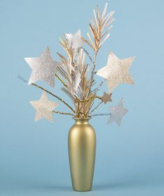 Set a festive New Year's Eve party table with a firecracker centerpiece.