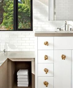Handles made from knotted lengths of ¾-inch manila rope add texture to this sleek, neutral bath. | Photo: Mariko Reed | thisoldhouse.com