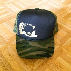 f212fcd7 Black/Camo Trucker with gold mermaid graphic. Mermaid Hat, Costume, Cute  Hats