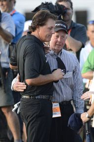 Phil Mickelson (left) hugs his father after the final round of theU.S. Open. (USA Today)