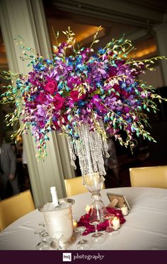 Gorgeous purple and blue centerpieces with hanging crystals   www.mqphotography.net
