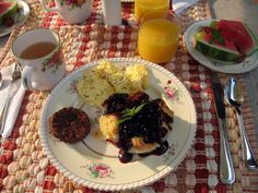 Stuffed french toast, pasture raised scrambled eggs from the farm up the road, fresh watermelon slices and veggie sausage for breakfast at Cedar House Inn and Yurts
