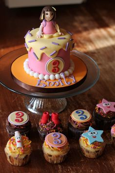 Dora cake with matching cuppies by Andreas SweetCakes, via Flickr