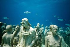 Jason DeCaires Taylor--La Evolución Silenciosa--400 life-size figures. Cancun, Mexico.--underwater sculpture installation that doubles as a coral reef