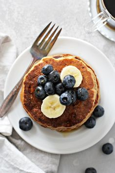 Light, fluffy and melt-in-your-mouth tender, these dairy free banana pancakes are a delicious way to start the day! Super easy to make, you'll never guess they're made entirely with whole wheat flour. Healthy and freezer friendly, they're also egg free, soy free and vegan. Optional add-ins and topping ideas included in the post.