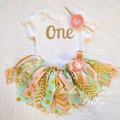 Pink, Mint and Gold Fabric tutu outfit~ First Birthday tutu set~ Shabby Chic Birthday Outfit~ Pink Mint Gold Birthday~ Birthday~ baby girl by ChelseaRoseBaby on Etsy https://www.etsy.com/listing/220017759/pink-mint-and-gold-fabric-tutu-outfit Ribbon Tutu, Tulle Tutu, Fabric Tutu, Gold Fabric, 1st Birthday Party Ideas For Girls, Baby Girl Birthday, First Birthday Parties, First Birthdays, Golden Birthday