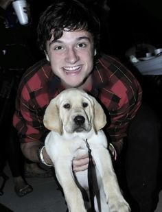 Josh with a puppy. Cute!! <3
