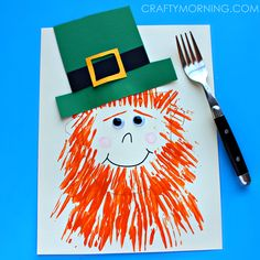 Make this fun leprechaun craft using fork prints for the orange beard. It's a fun st. patrick's day art project for kids to make. #craft
