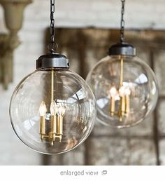 "$573 - find for less? 11"" round 19"" high.  glass globe pendants for over island? internal stems have brassy tone - match barn light?"