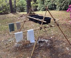 This Scout dishwashing rack made out of hiking poles is brilliant and keeps your dishwashing tubs off picnic tables and the ground.