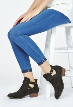 Anything but basic, this ankle boot is the perfect addition to your closet. It features side cutouts, crisscross straps, and a wood stacked heel....