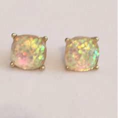 Large Opal Color Sparkle Stud Earrings Beautiful Large Sparkle Gumdrop Stud Earrings in a light Opal like color with glitter set in the resin stones. Gives an iridescent look. Approximate size of a dime or penny. New. No Trades, No PP. Boutique Jewelry Earrings