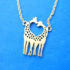 Mother and Baby Giraffe Shaped Animal Pendant Necklace in Gold sold by DOTOLY Animal Jewelry. Shop more products from DOTOLY Animal Jewelry on Storenvy, the home of independent small businesses all over the world. Giraffe Heart, Giraffe Family, Giraffe Necklace, Fake Gauge Earrings, Family Necklace, Sell Gold, Animal Jewelry, Engagement Gifts, Jewelery