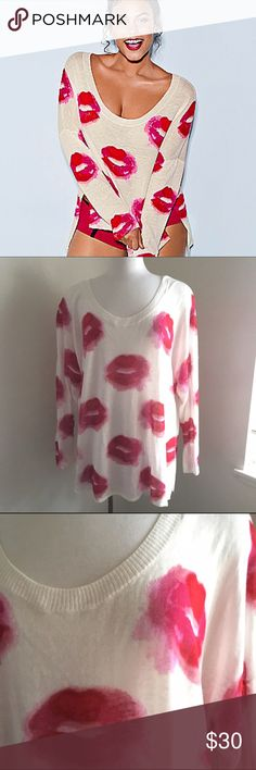 Lane Bryant sweater Beautiful sweater. It's a cream color with a red and pink lip print on it. Full length sleeves. It's very soft. Lightweight. Worn once. Size 22/24. Lane Bryant Sweaters