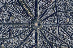 Arc de Triomphe: This Overview captures the Arc de Triomphe. The structure, which was commissioned in 1806 after Napoleon's victory at Austerlitz during the peak of his fortunes, is located at the center of twelve radiating avenues in Paris, France. Because of numerous delays, including the abdication of Napoleon, construction of the monument took nearly 30 years to complete
