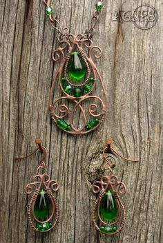 Soldered and wrapped jewel with copper patina and various green glass beads. Hand made earrings and pendant.
