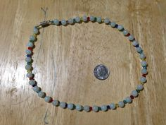 #Glass #Beaded #Childs #Necklace on Steel Beading wire: Light #green #beads with #multicolored bi-cone #spacer beads. #Blue #Red #Yellow #White #Teal by MamaSellsStuff on Etsy
