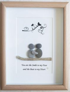 This is a beautiful small Pebble Art framed Picture of a Couple - You are the Smile to my Face and the Beat to my Heart handmade by myself using Pebbles and Driftwood Size of Picture incl Frame : approx. 22cm x 17cm This Picture is finished and only available as shown in Photo Thanks for