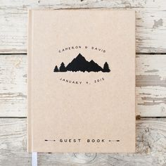 This original mountain wedding guest book can be customized with your names and wedding date above a unique mountain and tree motif. Your initials and dates are also on the spine. A perfect touch to your rustic mountain wedding reception! Available in three book sizes and with white,