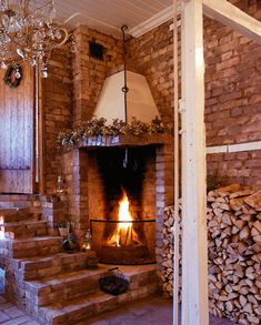 Brick wall, stairs, and corner fireplace - From THE ESSENCE OF THE GOOD LIFE™   http://www.pinterest.com/LeneGede/   https://www.facebook.com/pages/The-Essence-of-the-Good-Life/367136923392157
