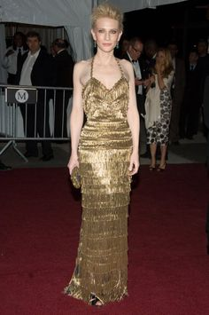 Pin for Later: Cate Blanchett Has the Most Impressive Red Carpet Résumé in Hollywood Cate Blanchett in Gold Balenciaga at the 2007 Met Gala For the 2007 Met Gala, Blanchett took the Poiret: King of Fashion theme to heart donning a royal-fringed Balenciaga.