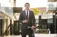 Handsome young business man with his modern bicycle. - Handsome young business man with his modern bicycle. Napoleon Hill, Bicycle, Handsome, Business, Modern, Style, Trendy Tree, Bicycle Kick, Bike