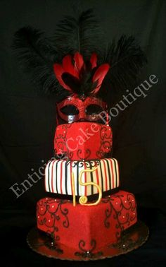 red, black, and white masquerade mask feather cake. Made of buttercream, fondant, and gumpaste.