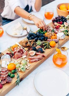 Make an edible centerpiece of charcuterie, plates of fruit, or containers of cookies – it will feed and impress your guests! Photo by Ashley Batz; Styling by Erin Hiemstra + Bianca Sotelo