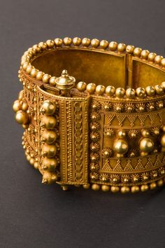 Gold bracelet with refined decoration by micro-granulation and applied elementsOrigin: Tamil Nadu, south India Age: Beginning of Materials: 22 carat gold Weight: Gold Bangles Design, Gold Earrings Designs, Gold Jewellery Design, Ethnic Jewelry, Luxury Jewelry, Indian Jewelry, 24k Gold Jewelry, Antique Jewelry, Ancient Jewelry