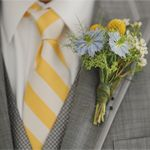 Grey suit, yellow striped tie an cute boutiniere.