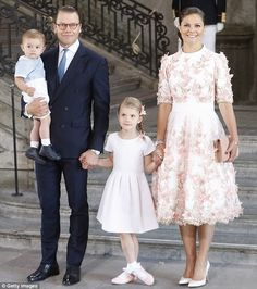 Picture-perfect family: Princess Victoria attended the service with her husband Prince Daniel and their children, Princess Estelle, five, and one-year-old Prince Oscar