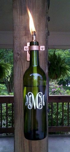 """The monogrammed lantern is made from a recycled wine bottle. This lantern will light your way on any dark night or get rid of those pesky bugs when burning citronella. The lantern makes a great gift for the """"green"""" person in your family, or for anyone who"""