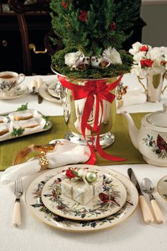 Stunning Christmas table arrangement: notice the small wrapped party favor on the plate.