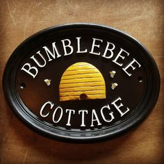 Double Rim Oval Cast House Name Sign A pretty hand painted house sign with bumble bee and honey hive design.With With or WITH may refer to: House Name Signs, House Names, Home Signs, Cottage Names, Cottage Signs, Hives And Honey, Honey Bees, Humble Bee, Bee House