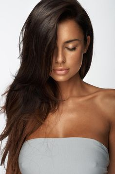 Tan looks awesome with dark brown hair