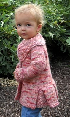 Free Knitting Pattern for Petite Panache Coat -Meghan Jones designed this charming jacket for babies and toddlers that features extra large offset collar, a flared waist and seed stitch cuffs, collar and pleats. Quick knit in chunky yarn. Sizes 3m, 6m, 12m, 18m, 2T, 4T
