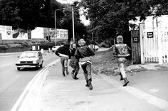 Dr. Martens - part of history, 1982    Punks and Skins running down a road in Wycombe Marsh, UK    (Photo credit: PYMCA/Gavin Watson)