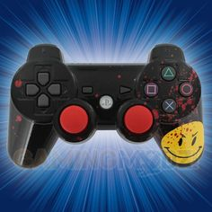 """Who watches the Watchmen? We are happy to introduce our new """"Who Watches Us"""" Rapid Fire Modded Controller for PlayStation 3. This is a redesign of a popular design we featured last year. Fans of the comic can appreciate the signature """"Happy Face"""" button graphic. Get yours while it's hot!"""