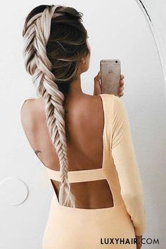 Braids and open back dresses are perfection! @emilyrosehannon wears her Ash Blonde #luxyhairextensions to create this long thick braid.                                                                                                                                                                                 Mais