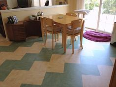 Great color and ziggurat pattern of linoleum tiles make a eclectic kitchen special.  by Studio Z Architecture