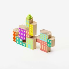 Build the world you want to see with Blockitecture®, a set of architectural building blocks. Cantilever and nest hexagonal blocks to create towers, cities and dwellings. The Deco set includes new colo