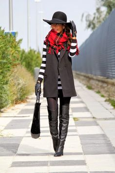 B&w stripe top, black vest, red plaid scarf,black jeans and booties