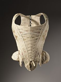 France  Woman's Corset, circa 1730-1740  Costume/clothing underwear/upper body, Silk plain weave with supplementary weft-float patterning, Center back length: 16 1/2 in. (41.91 cm)  Gift of Mr. Jack Cole (63.24.5)  Costume and Textiles Department.
