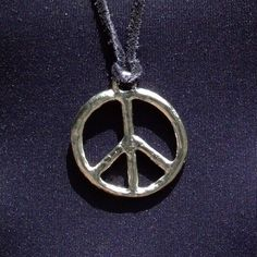 Leather necklace with metal peace sign pendant (large).
