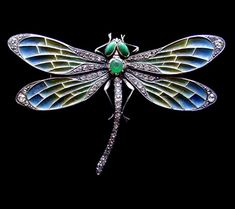 image from a gallery of vintage and/or antique objects. Jugendstil dragonfly brooch, a silver plique-a-jour dragonfly brooch  with turquoise eyes in gold settings, German, Pforzheim 1900
