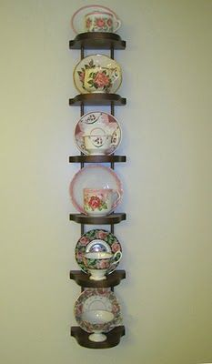 I have a set of tea cups that I'd love to display--this wouldn't be so hard to make, I think.