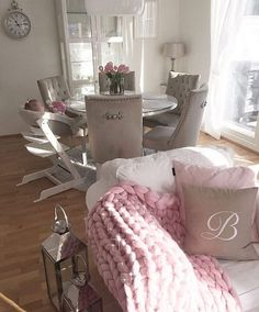 White, grey and baby pink living space.